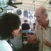 Russ Abbot in discussion with the lead singer after VIP gig